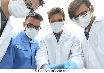 closeup. a team of doctors in protective masks.