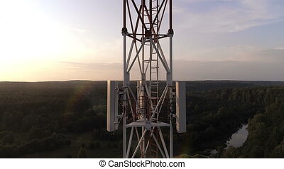 Closeup aerial view of the cellular telecom tower - Closeup...