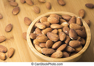 Closeup almonds in wooden bowl