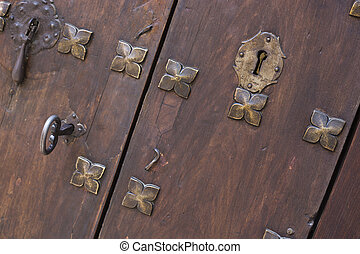 Closeup antique wooden door with key
