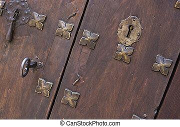 Closeup antique wooden door with key
