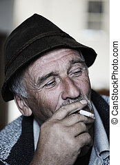 Closeup Artistic Photo of Aged Man With Grey Mustache...