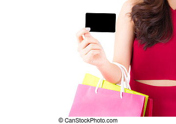 Closeup asian young woman with red dress holding a credit card and bag paper colorful isolated on white background.