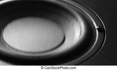 Closeup at moving sub-woofer. Speaker part. - Closeup at...