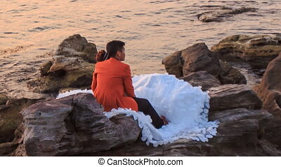 Closeup Backside Girl Guy Admire Scenery Sit on Rocks by Sea...