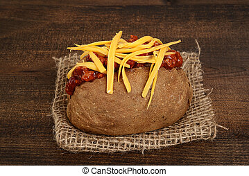 closeup baked potato with chili