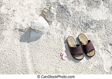 bamboo shoes on white sand background
