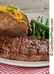 Closeup barbecue strip loin steak with vegetables