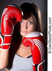 Closeup beautiful girl with the boxing gloves