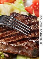 closeup, bistecca, forchetta, cotto ferri