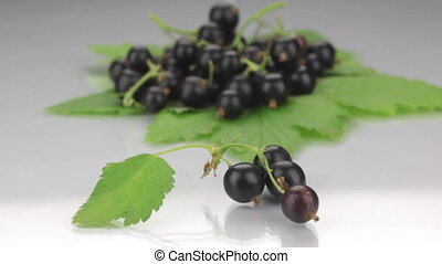 Closeup black currant on a background made of black currant.