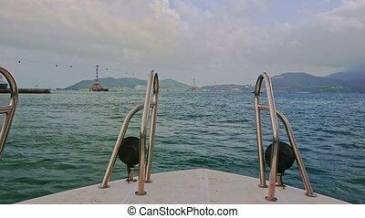 Closeup Boat Head Rails against Azure Sea Ships Distant...