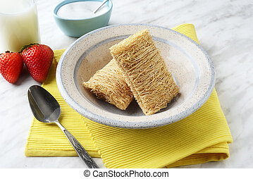 closeup bowl of shredded wheat cereal
