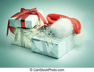 closeup. boxes with gifts and a Santa Claus hat.