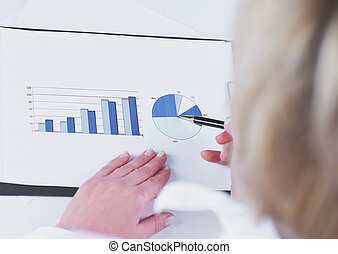 closeup. business woman analyzing marketing graphics. isolated on white