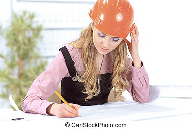 Business woman Drawing Blueprint At Office Desk