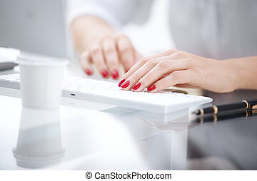 closeup. business woman typing on computer keyboard. people and technology