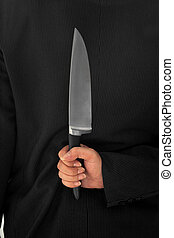 Closeup Businessman Holding Knife Behind His Back conceptual image