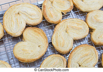 Closeup butterfly pie or palmier cookie, sweet and dessert concept