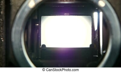Closeup camera lens. Camera shutter aperture transition in slow motion