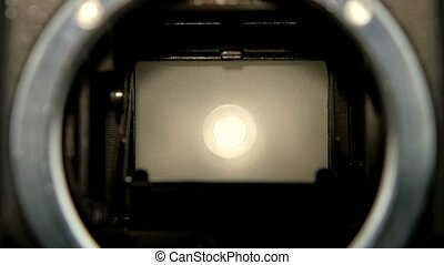 Closeup camera lens. Diaphragm camera shutter blade in slow motion