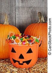 candy filled halloween pumpkin - closeup candy filled...