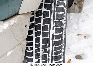 closeup car tire tread protector full snow winter - closeup...