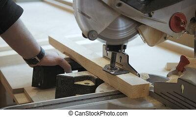 Closeup Carpenter Cutting Plank Wood by Circular Saw