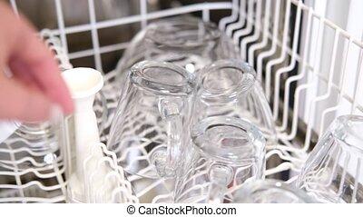 Closeup caucasian Woman's Hand Opening Dishwashe, pushing ...
