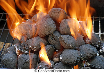closeup charcoal barbecue briquettes with flames
