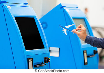 Closeup check-in for flight or buying airplane tickets at airport