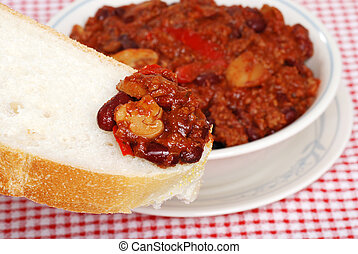 chili on a slice of fresh bread
