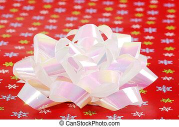 christmas bow on snowflake paper