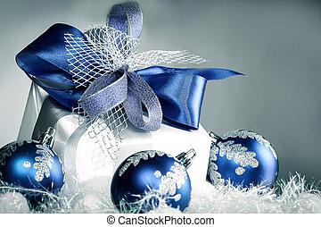 closeup .Christmas gift and blue Christmas balls on a festive wh