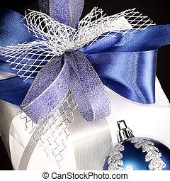 closeup .Christmas gift and blue Christmas balls on a festive w