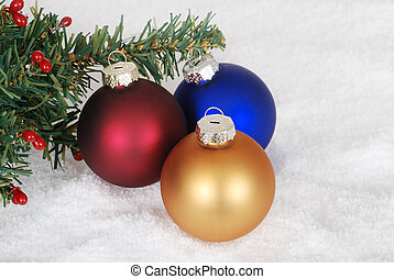 Christmas ornaments and tree branch