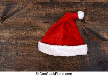 christmas santa hat on wood