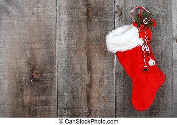 Christmas sock and wreath on wood - closeup Christmas sock...