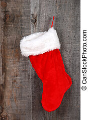 closeup christmas sock hanging on old barn board