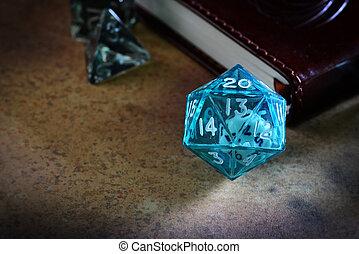 closeup clear blue d & d dice with book