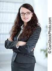 closeup. confident business woman on blurred background office