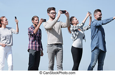 closeup. confident young people make selfies.