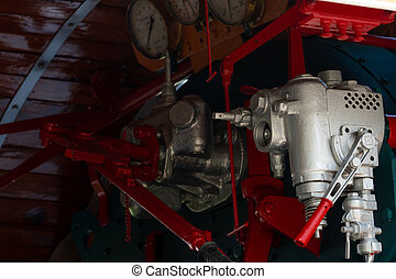 Closeup control valve of steam locomotive. Directional valves allow steam to flow through the steam locomotive engine drive system. Railway transportation industry. The train operated on furnace oil.