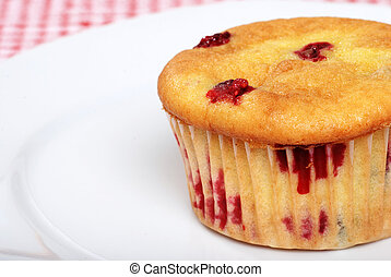 cranberry muffin on a plate