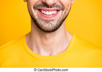 Closeup cropped photo of amazing macho guy looking mirror examining teeth after dental laser cleaning wear casual t-shirt isolated yellow color background