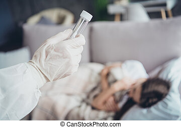 Closeup cropped photo of young sick patient lady lying sofa unwell call ambulance guy doc virologist, collected saliva mouth probe flu cold covid test wear gloves protective uniform indoors