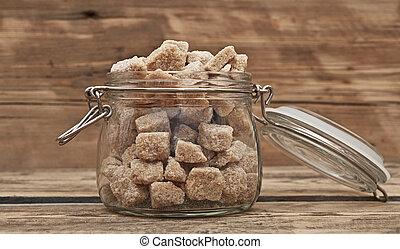 closeup, cubes, sucre brun, pot, verre