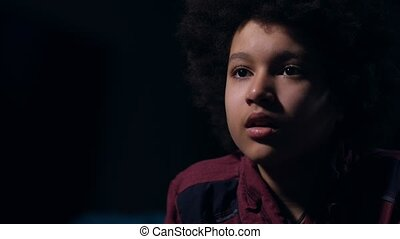 Closeup cute mixed race teen drinking during film - Scared...