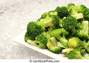 closeup detail of boiled broccoli vegetable on plate