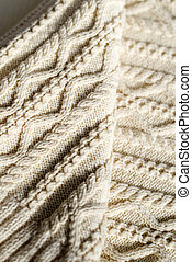 closeup detail of woven handicraft knit woolen design texture and knitting needle. Fabric white copy space background